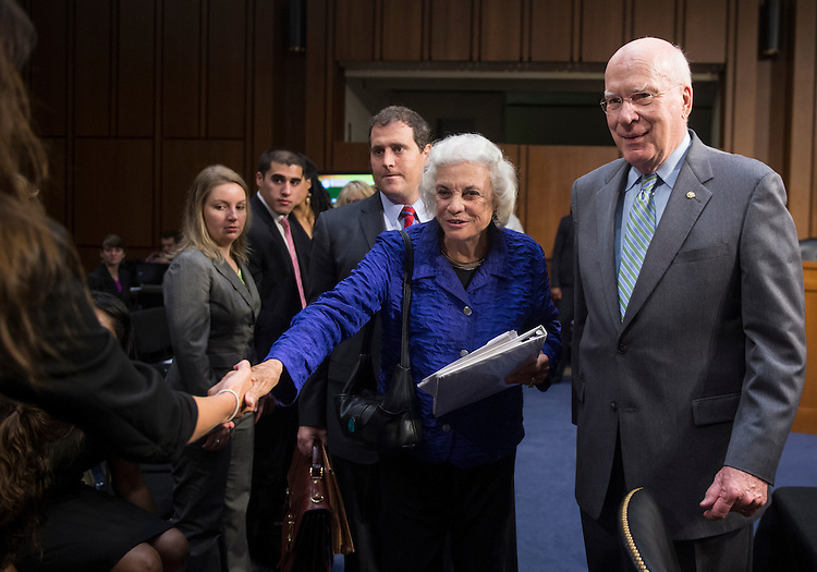 "UNITED STATES - JULY 25: Chairman Patrick Leahy, D-Vt., escorts former Supreme Court Justice Sandra Day O'Connor to the witness table as she arrives for the Senate Judiciary Committee hearing on ""Ensuring Judicial Independence Through Civics Education"" on Wednesday, July 25, 2012. (Photo By Bill Clark/CQ Roll Call)"