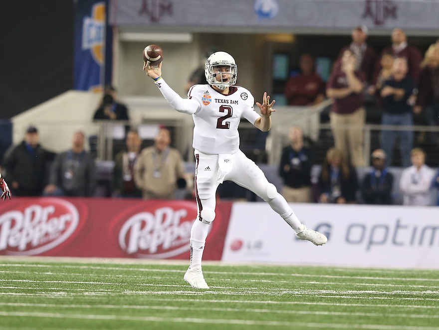 Jan 4, 2013; Arlington, TX, USA; Texas A&M Aggies quarterback Johnny Manziel (2) throws a pass against the Oklahoma Sooners during the Cotton Bowl at Cowboys Stadium.  Mandatory Credit: Tim Heitman-USA TODAY Sports