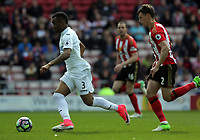 (L-R) Jordan Ayew of Swansea City chased by Billy Jones of Sunderland during the Premier League match between Sunderland and Swansea City at the Stadium of Light, Sunderland, England, UK. Saturday 13 May 2017