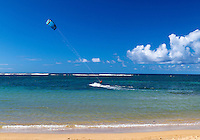 A kite surfer at Anini Beach, northern Kaua'i.