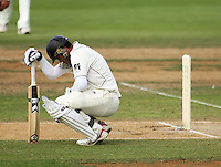 NZ's Ross Taylor crouches down after being hit by a delivery from Virendar Sehwag during day four of the 3rd test between the New Zealand Black Caps and India at Allied Prime Basin Reserve, Wellington, New Zealand on Monday, 6 April 2009. Photo: Dave Lintott / lintottphoto.co.nz.