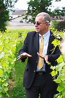 Jean Herve Chiquet co-owner and co-winemaker showing the vines and explaining their philosophy In the vineyard behind the house in the garden, Champagne Jacquesson in Dizy, Vallee de la Marne, Champagne, Marne, Ardennes, France, low light grainy grain