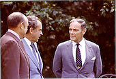 Washington, D.C. - July 7, 1973 -- White House Chief of Staff General Alexander M. Haig, Jr., right center, shares some thoughts with United States President Richard M. Nixon, left center, and Melvin Laird, Counselor to the President for Domestic Affairs, left, in the Rose Garden at the White House in Washington, D.C. on July 7, 1973..Credit: White House / CNP