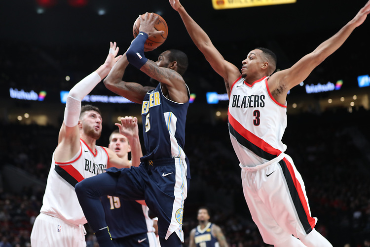 Portland Trail Blazers center Jusuf Nurkic (27) and Portland Trail Blazers guard CJ McCollum (3) defend Denver Nuggets guard Will Barton (5) in the first half at Moda Center. <br /> Photo by Jaime Valdez