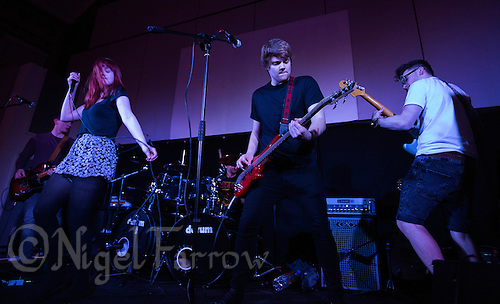 06 APR 2015 - STOWMARKET, GBR - Andy Moore (second from right) on bass guitar performs with Dom Clarke (left), Helena Lewis (second from the left), Lee Jaggard (centre) and Will Pearmain (right) during the Lost Lungs gig at the John Peel Centre for Creative Arts in Stowmarket, Great Britain (PHOTO COPYRIGHT © 2015 NIGEL FARROW, ALL RIGHTS RESERVED)