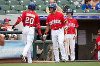 Round Rock Express designated hitter Matt Kata #15 greets teammate Julio Borbon #20 after he scored during the Pacific Coast League baseball game against the Iowa Cubs on April 15, 2012 at the Dell Diamond in Round Rock, Texas. The Express beat the Cubs 11-10 in 13 innings. (Andrew Woolley / Four Seam Images).