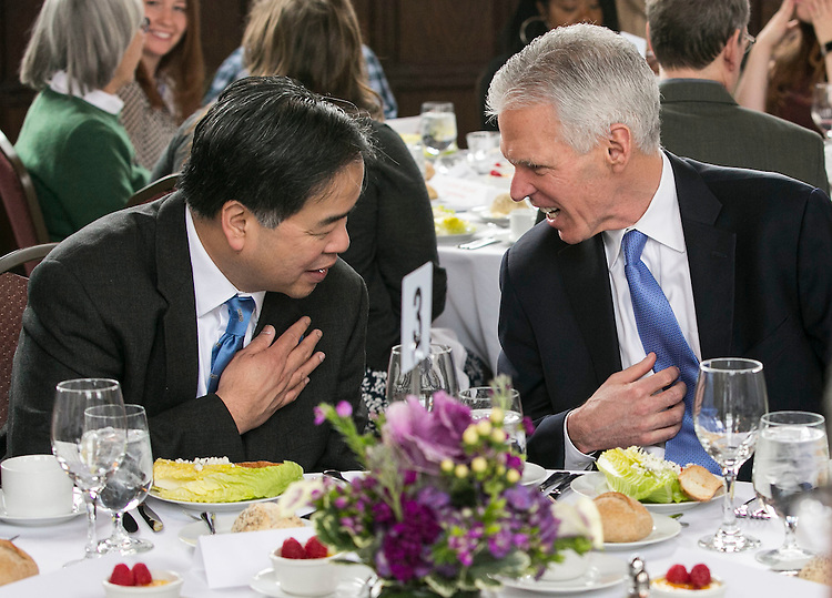Dr. Gabriel Esteban, president-elect of DePaul University, and Jim Ryan, board of trustee member and chair of the presidential search committee, share a laugh over tie colors during lunch as they join faculty and staff at Cortelyou Commons Thursday, February 16, 2017, on the Lincoln Park Campus. Dr. Esteban was named the university's 12th president during a day of welcoming events at both the Loop and Lincoln Park Campuses. Esteban will succeed the Rev. Dennis H. Holtschneider, C.M., who has served as president since July 2004 and was recently named the executive vice president and chief operations officer at Ascension, a faith-based health care organization. (DePaul University/Jamie Moncrief)