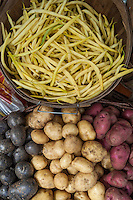 Organic, non-GMO beans and potatoes displayed at a farmers market