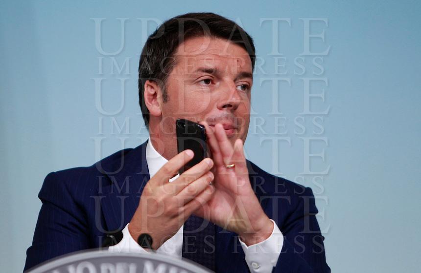Il Presidente del Consiglio Matteo Renzi tiene una conferenza stampa al termine del Consiglio dei Ministri a Palazzo Chigi, Roma, 10 luglio 2014.<br /> Italian Premier Matteo Renzi attends a press conference at the end of a cabinet meeting at Chigi Palace, Rome, 10 July 2014.<br /> UPDATE IMAGES PRESS/Isabella Bonotto