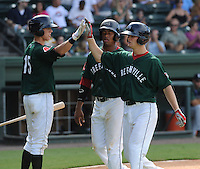 Center fielder Cody Koback (18) of the Greenville Drive, right, is congratulated after hitting a home run in the fourth inning of a game against the Lexington Legends on July 22, 2012, at Fluor Field at the West End in Greenville, South Carolina. (Tom Priddy/Four Seam Images)