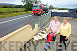 DANGER: The Brennan family from Kilflynn beside the wall which has been repeatedly knocked by speeding cars. Pictured are Eileen Brennan with her daughter-in-law Brenda and grandson Conor.