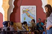 Roma 27 Giugno 2015<br /> Francesca Immacolata Chaouqui (R),ex componente della Commissione Cosea sulle strutture finanziarie del Vaticano, imputata al  processo Vatileaks, con i volontari al  centro di accoglienza  per migrati Baobab, vicino alla stazione Tiburtina.<br /> Al centro di accoglienza  per migrati Baobab, vicino alla stazione Tiburtina continua afflusso di migranti  provenienti soprattutto dall' Eritrea, ogni giorno circa 700 migranti mangiano al centro  e 300 sono ospitati la notte. Medici volontari controllano lo stato di salute dei rifugiati al centro Baobab.<br /> Rome June 27, 2015<br /> Francesca Immacolata Chaouqui (R), former member of Cosea Commission on the financial structures of the Vatican, imputed to the process Vatileaks,with the volunteers at the reception centre for immigrants  Baobab, in Tiburtina neighbourhood.<br /> At the Humanitarian emergency reception centre for immigrants, Baobab, in Tiburtina neighbourhood. continuous influx of migrants coming mainly from 'Eritrea, every day about 700 migrants eat in the centre and 300 are housed at night. Volunteer doctors monitor the health of refugees at the center Baobab.