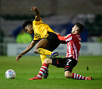 Wolverhampton Wanderers U21's Niall Ennis is tackled by Lincoln City's Tom Pett<br /> <br /> Photographer Chris Vaughan/CameraSport<br /> <br /> The EFL Checkatrade Trophy Northern Group H - Lincoln City v Wolverhampton Wanderers U21 - Tuesday 6th November 2018 - Sincil Bank - Lincoln<br />  <br /> World Copyright © 2018 CameraSport. All rights reserved. 43 Linden Ave. Countesthorpe. Leicester. England. LE8 5PG - Tel: +44 (0) 116 277 4147 - admin@camerasport.com - www.camerasport.com