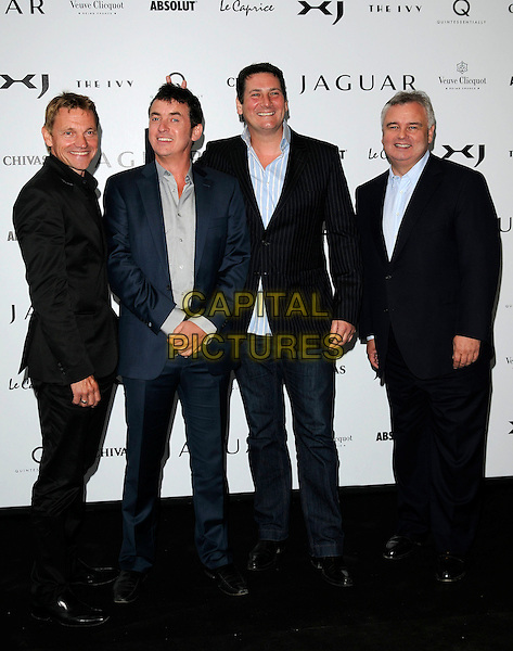GUEST, SHANE RICHIE, TONY HADLEY & EAMONN HOLMES.The New Jaguar XJ launch party, Saatchi Gallery, Duke of York's HQ, London, England. .July 9th, 2009 .full length black blue suit shirt beige hand fingers funny bunny ears .CAP/CAN.©Can Nguyen/Capital Pictures.