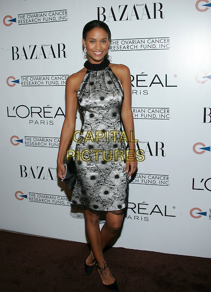 JOY BRYANT.L?Oreal Paris® Presents the ?As Seen In? Harper?s Bazaar? event to benefit the Ovarian Cancer Research Fund held at The Lindbrook Gallery in Westwood, California  .December 8th,2005.Ref: DVS.full length  black halterneck dress.www.capitalpictures.com.sales@capitalpictures.com.Supplied By Capital PIctures