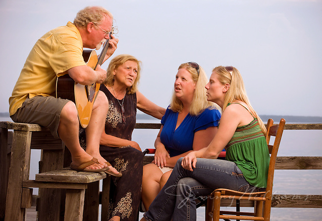 A family gathers on the porch of their coastal North Carolina home to play music together