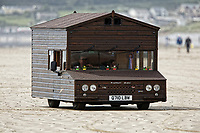"""Pictured: The Fastest Shed in Pendine, west Wales, UK. Saturday 12 May 2018<br /> Re: A motorised shed has broken its own land speed record on a Welsh beach as it hit over 100mph.<br /> The Fastest Shed smashed its previous 80mph (129km/h) record for the fastest shed at a land speed event at Pendine Sands in Carmarthenshire.<br /> Its owner, gardener Kevin Nicks said it was """"marvellous"""" to hit 101.043mph (160 km/h) in what he said was the only road legal shed with an engine in the world.<br /> Mr Nicks, from Chipping Norton in Oxfordshire, created his bespoke shed on wheels, which now boasts a turbo-charged 450 brake horsepower turbo engine that is more powerful than many sports cars."""