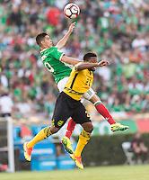 Pasadena, CA - Thursday June 09, 2016: Raul Jimenez, Jermaine Taylor during a Copa America Centenario Group C match between Mexico (MEX) and Jamaica (JAM) at Rose Bowl Stadium.