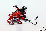 19 MAR 2016: Players fight for the puck on the ice during the Division lll Women's Ice Hockey Championship, held at the Ronald B. Stafford Ice Arena in Plattsburgh, NY. Plattsburgh defeated Wis.-River Falls 5-1 for the national title. Courtney Moriarity #18 for Plattsburgh and Jessie Anderson #25 for Wis.-River Falls are down during first period action. Nancie Battaglia/NCAA Photos