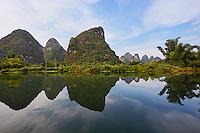 Karst formations reflected on Yulong River, Yangshuo, China
