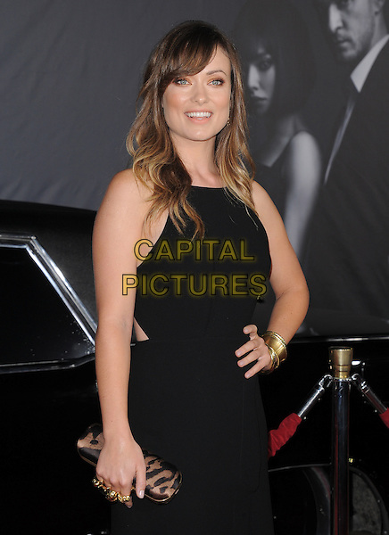 Olivia Wilde.The Regency Enterprises L.A. Premiere of 'In Time' held at The Regency Village Theatre in Westwood, California, USA..October 20th, 2011.half length gold side rings knuckleduster  clutch bag  black sleeveless dress hand on hip.CAP/RKE/DVS.©DVS/RockinExposures/Capital Pictures.
