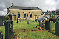 A gravedigger finishing a grave in a country church at Whitewell, Clitheroe, Lancashire.....Copyright..John Eveson, Dinkling Green Farm, Whitewell, Clitheroe, Lancashire. BB7 3BN.01995 61280. 07973 482705.j.r.eveson@btinternet.com.www.johneveson.com