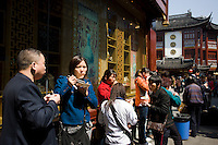People eating street food in the Yu Garden Bazaar Market, Shanghai, China