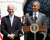 United States President Barack Obama (R) speaks  during the Wounded Warrior Ride while Vice President Joe Biden (L), listens at the White House, in Washington, DC, April 14, 2016.  The event helps raise awareness to the public about severely injured veterans and provides rehabilitation opportunities. <br /> Credit: Aude Guerrucci / Pool via CNP