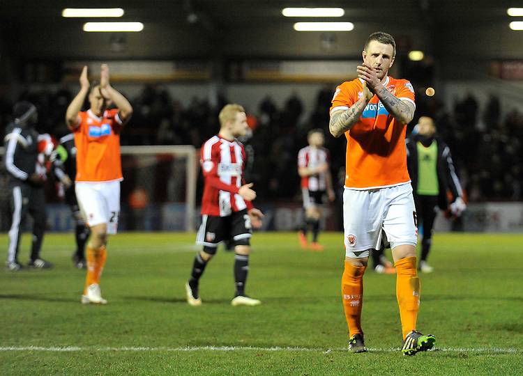 Blackpool's Peter Clarke applauds the travelling fans after the 4-0 defeat to Brentford<br /> <br /> Photographer Ashley Western/CameraSport<br /> <br /> Football - The Football League Sky Bet League One - Brentford v Blackpool - Tuesday 24th February 2015 - Griffin Park - London<br /> <br /> &copy; CameraSport - 43 Linden Ave. Countesthorpe. Leicester. England. LE8 5PG - Tel: +44 (0) 116 277 4147 - admin@camerasport.com - www.camerasport.com