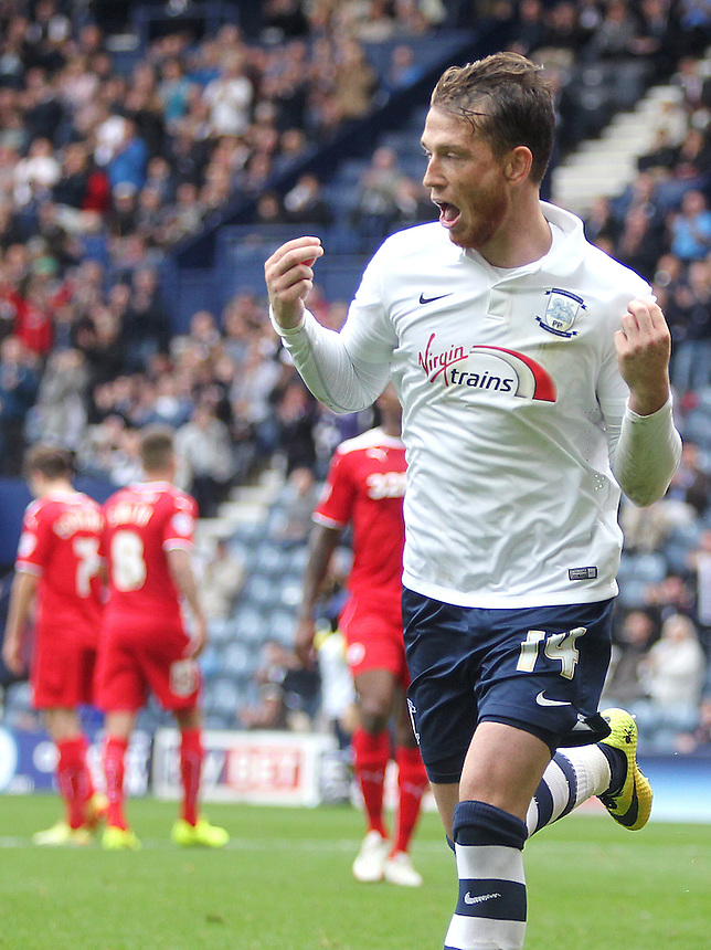 Preston North End's Joe Garner celebrates scoring his sides second goal from the penalty spot<br /> Photographer Rich Linley/CameraSport<br /> <br /> Football - The Football League Sky Bet League One - Preston North End v Crawley Town - Saturday 20th September 2014 - Deepdale - Preston<br /> <br /> &copy; CameraSport - 43 Linden Ave. Countesthorpe. Leicester. England. LE8 5PG - Tel: +44 (0) 116 277 4147 - admin@camerasport.com - www.camerasport.com