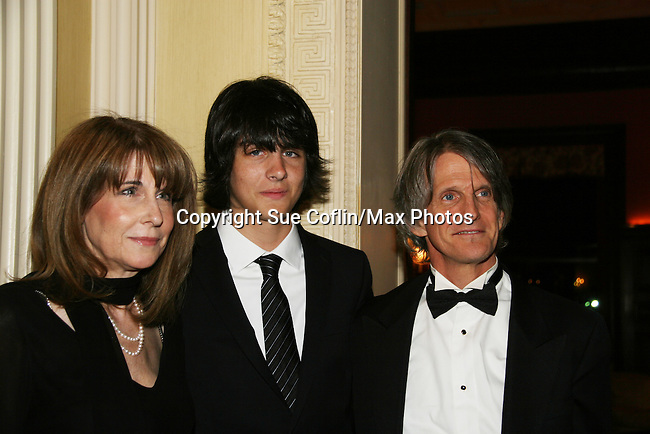 """Mick Hazen with his mom Julie and dad Craig as they attend """"When You Wish Upon A Star"""" on March 6, 2010 which benefits Child Life and Creative Arts Therapy Department, Maria Fareri Children's Hospital at Westchester Medical Center, Westchester, New York. The evening began with a cocktail reception and silent auction, a children's performance (singing) followed by dinner, dancing and more. (Photo by Sue Coflin/Max Photos)"""