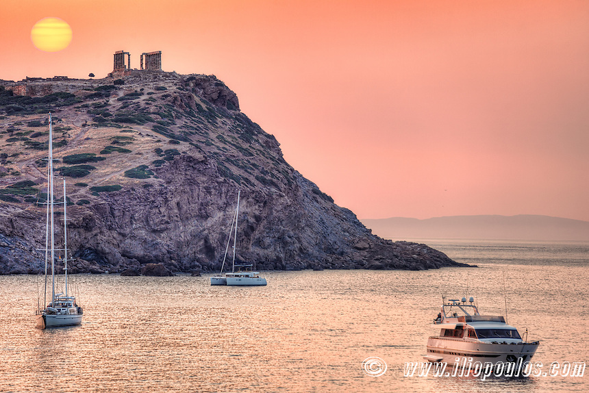 The sunrise at the temple of Poseidon (448–440 B.C.) in Sounio, Greece