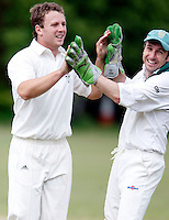 B Hackshall (L) of North London celebrates with Mark Askew (R) after dismissing K Makwana during the Middlesex County Cricket League Division 2 game between North London and Hornsey at Park Road, Crouch End on Sat May 15, 2010