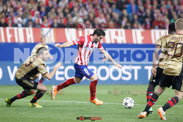 Atletico de Madrid´s Raul Garcia (R) and Milan´s Adil Rami during 16th Champions League soccer match at Vicente Calderon stadium in Madrid, Spain. March 11, 2014. (ALTERPHOTOS/Victor Blanco)