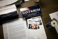 Campaign materials lay on a table at the Rick Santorum New Hampshire campaign headquarters in Bedford, New Hampshire, on Jan. 7, 2012.  Santorum is seeking the 2012 Republican presidential nomination.