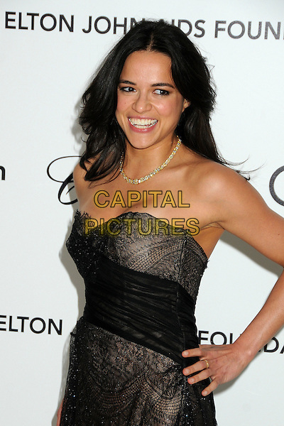 Michelle Rodriguez.20th Annual Elton John Academy Awards Viewing Party held at West Hollywood Park, West Hollywood, California, USA..February 26th, 2012.half length black sheer tulle strapless dress lace gold necklace hand on hip oscars.CAP/ADM/BP.©Byron Purvis/AdMedia/Capital Pictures.