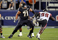 Florida International University football player offensive lineman Caylin Hauptmann (71) plays against the University of Louisiana-Lafayette on September 24, 2011 at Miami, Florida. Louisiana-Lafayette won the game 36-31. .