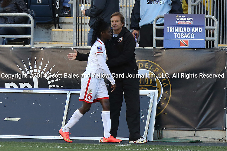 26 October 2014: Trinidad & Tobago Randy Waldrum (USA) with Khadidra Debessete (TRI) (6). The Trinidad & Tobago Women's National Team played the Mexico Women's National Team at PPL Park in Chester, Pennsylvania in the 2014 CONCACAF Women's Championship Third Place game. Mexico won the game 4-2 after extra time. With the win, Mexico qualified for next year's Women's World Cup in Canada and Trinidad & Tobago face playoff for spot against Ecuador.