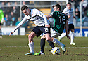 Raith Rovers' Ryan Conroy and Hib's Lewis Stevenson challenge for the ball.