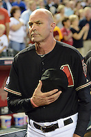 Arizona Diamondbacks manager Kirk Gibson (23) during the national anthem before a game against the Washington Nationals at Chase Field on September 28, 2013 in Phoenix, Arizona.  Washington defeated Arizona 2-0.  (Mike Janes/Four Seam Images)