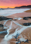 "Kauai, Hawaii:<br /> Surf patterns and reflections on Kauapea ""Secret"" beach at sunrise, with Kilauea Point Lighthouse on the distant point"