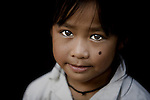 A young girl in rural Laos, near Luang Prabang.