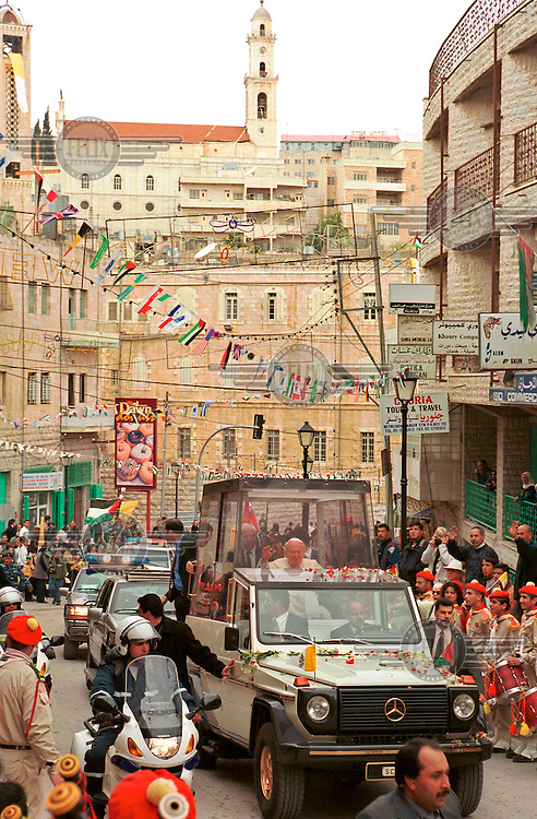 Pope John Paul II arrives in the West Bank Palestinian city of Bethlehem, during his historic visit to the Holy Land..