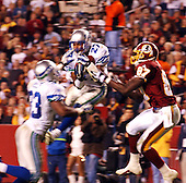 Landover, MD - November 4, 2001 -- Seattle Seahawk cornerback Willie Williams (27) intercepts a pass intended for Washington Redskin wide receiver Rod Gardner (87) in third quarter action of the the game at FedEx Field in Landover, Maryland on Sunday, November 4, 2001.  The Redskins won the game 27 - 14.<br /> Credit: Ron Sachs / CNP