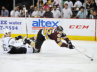 Chicago Wolves' Pat Cannone falls over San Antonio Rampage's Jonathan Racine during the third period of an AHL hockey game, Friday, Oct. 4, 2013, in San Antonio. Chicago won 2-1. (Darren Abate/M3D14.com)