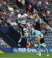 Preston North End's Daniel Johnson jumps with  Burnley's Ben Mee<br /> <br /> Photographer Mick Walker/CameraSport<br /> <br /> Football Pre-Season Friendly - Preston North End  v Burnley FC  - Monday 23st July 2018 - Deepdale  - Preston<br /> <br /> World Copyright &copy; 2018 CameraSport. All rights reserved. 43 Linden Ave. Countesthorpe. Leicester. England. LE8 5PG - Tel: +44 (0) 116 277 4147 - admin@camerasport.com - www.camerasport.com