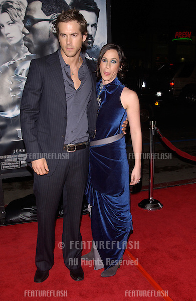Dec 7, 2004; Los Angeles, CA: Actor RYAN REYNOLDS & fiance?e singer ALANIS MORISSETTE at the Los Angeles premiere of his new movie Blade: Trinity..