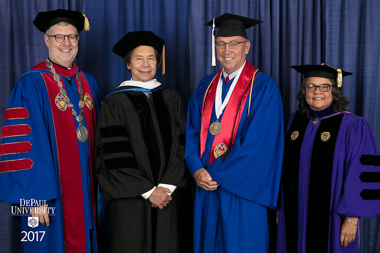 Left to right, the Rev. Dennis H. Holtschneider, C.M., president of DePaul, commencement speaker and honorary degree recipient Stuart Dybek, poet and fiction writer, Jerry T. Lange, student speaker, Marisa Alicea, dean of the School for New Learning. DePaul University School for New Learning held its commencement ceremony, Saturday, June 10, 2017, at the Rosemont Theatre in Rosemont, IL. The Rev. Dennis H. Holtschneider, C.M., president of DePaul, conferred the degrees. (DePaul University/Jeff Carrion)