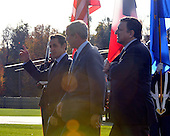 Camp David, MD - October 18, 2008 --  United States President George W. Bush, center, President Nicolas Sarkozy of France, who also serves as this year's rotating President of the European Union (EU), left, and President José Manuel Barroso of the European Commission (EC), right, walk to golf carts after making remarks at the Presidential Retreat near Thurmont, Maryland for talks on Saturday, October 18, 2008.  The two European leaders stopped at Camp David to meet with President Bush to discuss the economy on their way home from a summit in Canada to try to convince Bush to support a summit by year's end to try to reform the world financial system..Credit: Ron Sachs / Pool via CNP