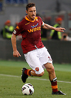 Calcio, Serie A: Roma vs Chievo Verona. Roma, stadio Olimpico, 7 maggio 2013..AS Roma forward Francesco Totti in action during the Italian Serie A football match between AS Roma and ChievoVerona at Rome's Olympic stadium, 7 May 2013..UPDATE IMAGES PRESS/Riccardo De Luca